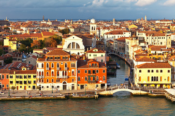 Venice. View on Church of San Trovaso and a repair manufactory for Venetian gondolas Squero di San Trovaso from above in the rays of the setting sun