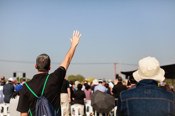 Christian praying with raised hand worship.