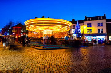 Motion blurred carousel at night in Waterford, Ireland