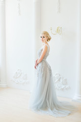 Fashion bride in gray dress with make-up smoky eyes