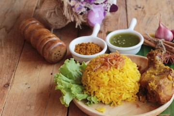 chicken biryani with rice delicious and sauce.