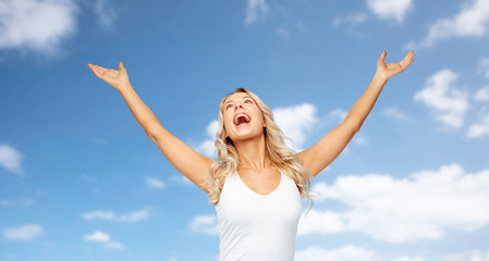 happy woman celebrating victory over blue sky
