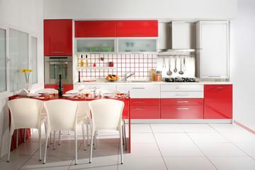 home interior shot of clean modern red kitchen desing