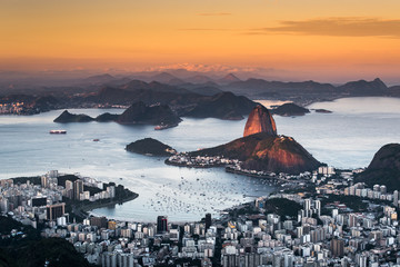 Wall Mural - Beautiful View of Rio de Janeiro by Sunset With the Sunlight Still Falling on the Sugarloaf Mountain