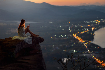 Beautiful Woman are using smartphone on after sunset