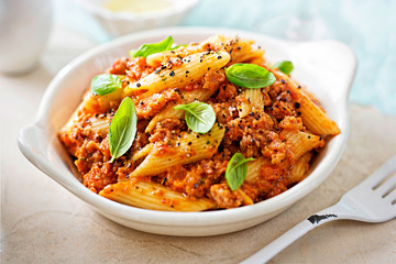 Italian tuscan sausage penne in tomato sauce with basil