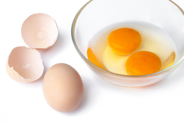 Egg, Hen Eggs and cracking eggs in a Glass bowl with brown eggs shell on white background