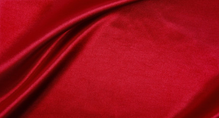 Smooth elegant red silk or satin luxury cloth texture as abstract background. Luxurious background design