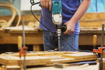 Carpenter using drill