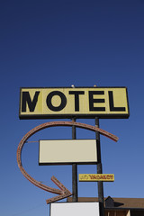 Motel sign against clear sky