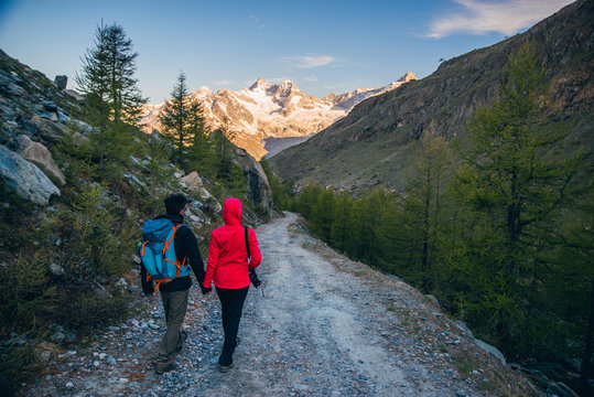 Couple hiking in Swiss Alps
