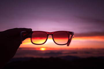 Sunset through the the eye of sunglasses.