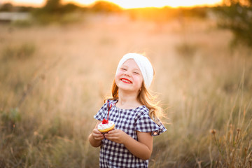 Patriotic girl with fourth of July cupcake