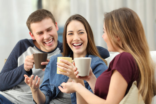 Friends talking and laughing loud at home
