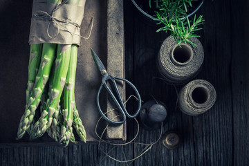 Green asparagus and fresh rosemary on rustic table