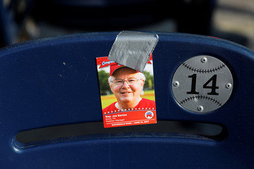 A baseball card with an image of Rep. Joe Barton (R-TX) is seen prior to the Congressional Baseball Game at Nationals Park in Washington