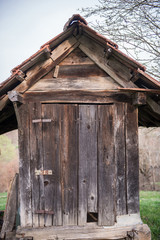 Small wooden outdoors toilet