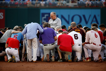 Patrick Conroy, Chaplain of the House of Representatives, leads Democrats and Republicans in prayer before they face off in the annual Congressional Baseball Game at Nationals Park in Washington