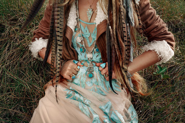 beautiful young boho girl with feathers close up