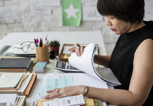 Adult asian woman working on payment bills accounting summary data