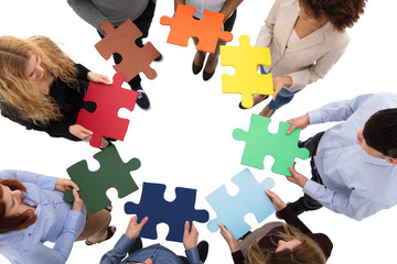 Group Of College Students Solving Puzzle