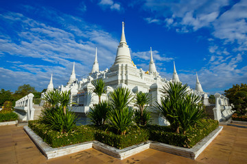 A large, elaborate white Buddhist Pagoda with multiple spires at Wat Asokara Temple in Thailand