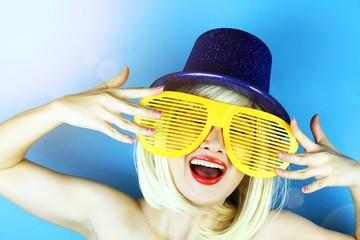 Playful girl with funny glasses, Happy naughty blonde hair woman with Large funny glasses. Party time.