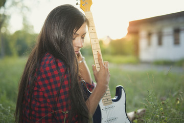 Girl with electric guitar.