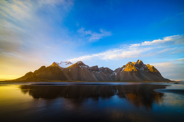 Vestrahorn mountain with black volcanic lava sand dunes at sunset, Stokksnes, Iceland