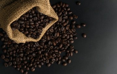 coffee beans in sack on black background