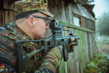 sniper with automatic rifle . airsoft