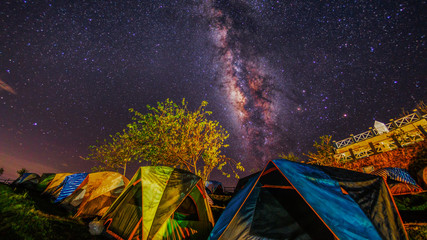 Long exposure photograph of milky way over camping tent in phu thap boek,Pechabun,Thailand