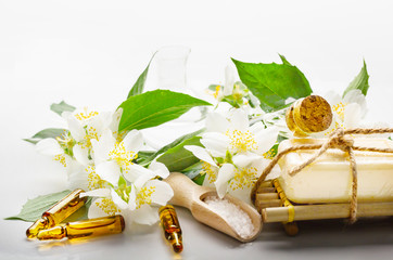 Spa setting with jasmine essential oil and flowers