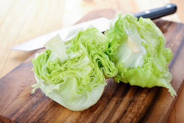 fresh green iceberg lettuce on cutting board