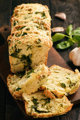 Homemade herb bread loaf with garlic and cheese.