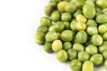 Pile of fresh raw green peas isolated over white background with copy space