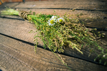 Sheaf of hay on a wooden background.