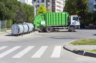 garbage truck with recycle bin in the city
