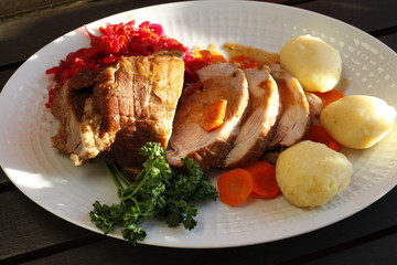 roast meat with dumplings, carrots and red cabbage
