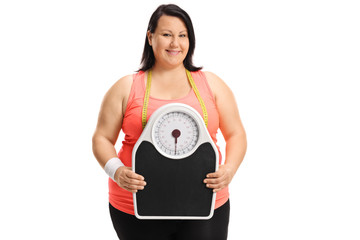 Overweight woman holding a weight scale