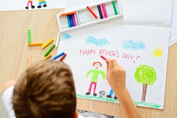 Child drawing and greeting card for his father