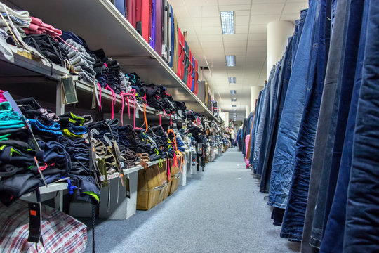 Shop with pants, clothing and bags.
