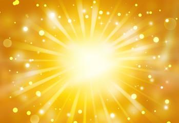 Golden glitter sparkles rays lights bokeh Festive Elegant abstract background.