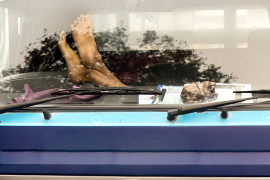 Male feet on the dashboard of the truck
