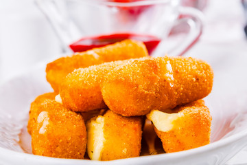 Fried cheese sticks with sauce