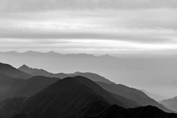 Black and white photo view to the foggy mountains from the summit of Mitsutōge in Japan