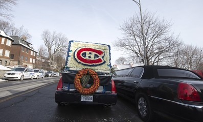 "A flower arrangement of the logo for the Montreal Canadiens hockey team is seen on a cortege car arriving with the hearse of Richard ""Dickie"" Moore for his funeral in Montreal"