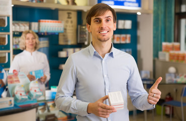 Young happy man near counter