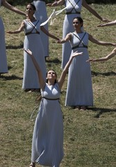 Priestesses release a dove as they attend the Olympic flame lighting ceremony for the Rio 2016 Olympic Games inside the ancient Olympic Stadium on the site of ancient Olympia