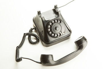 Old rotary phone on white background